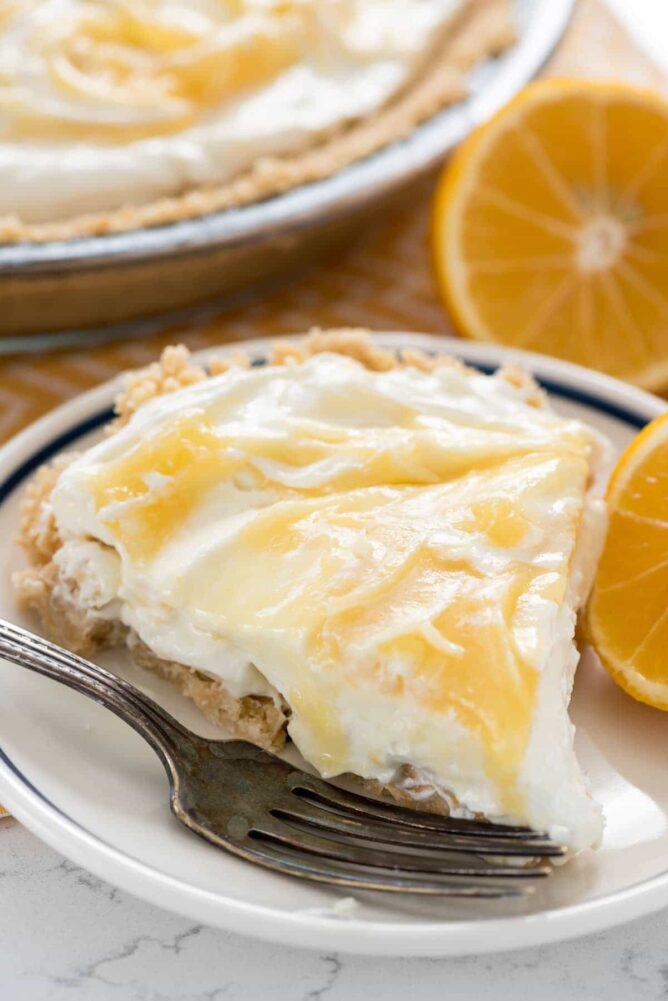 Slice of Lemon Cheesecake on a blue and white plate with a fork