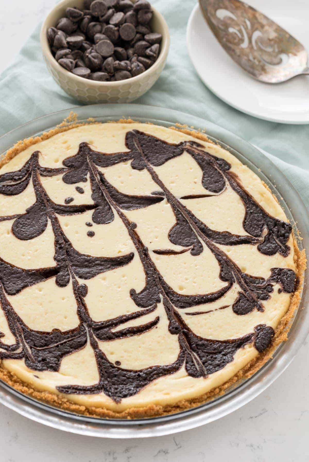 Chocolate Swirl Cheesecake Pie - this baked cheesecake recipe is so easy! No water bath or fussy steps, just a creamy cheesecake swirled with chocolate!