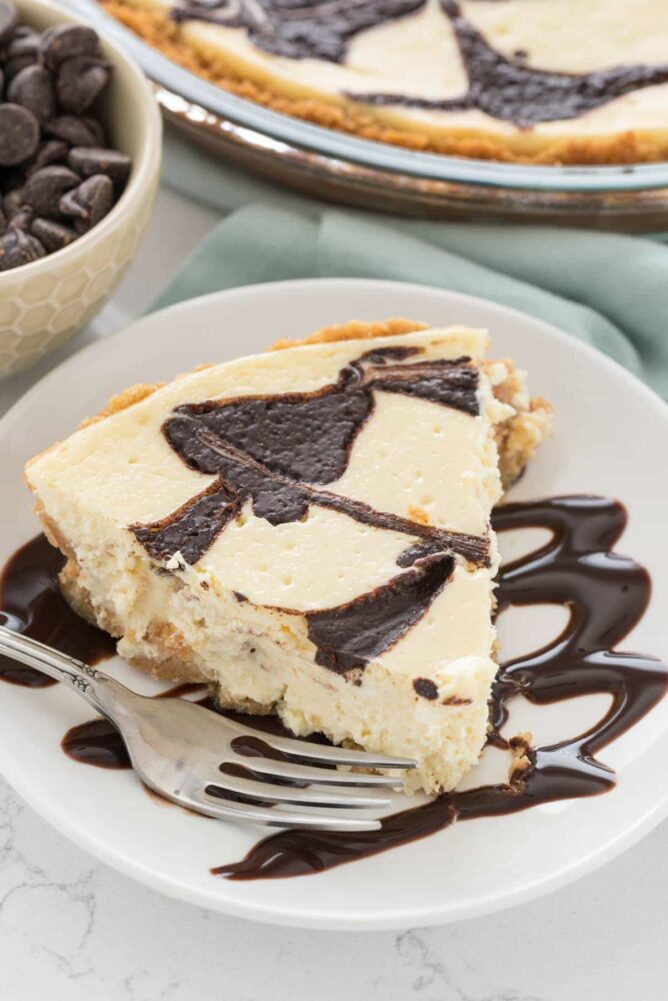 Slice of Cheesecake Pie on a white plate