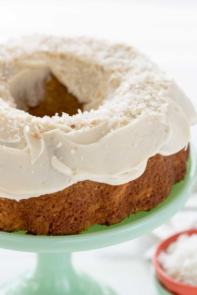 Coconut Carrot cake on a green Cake stand
