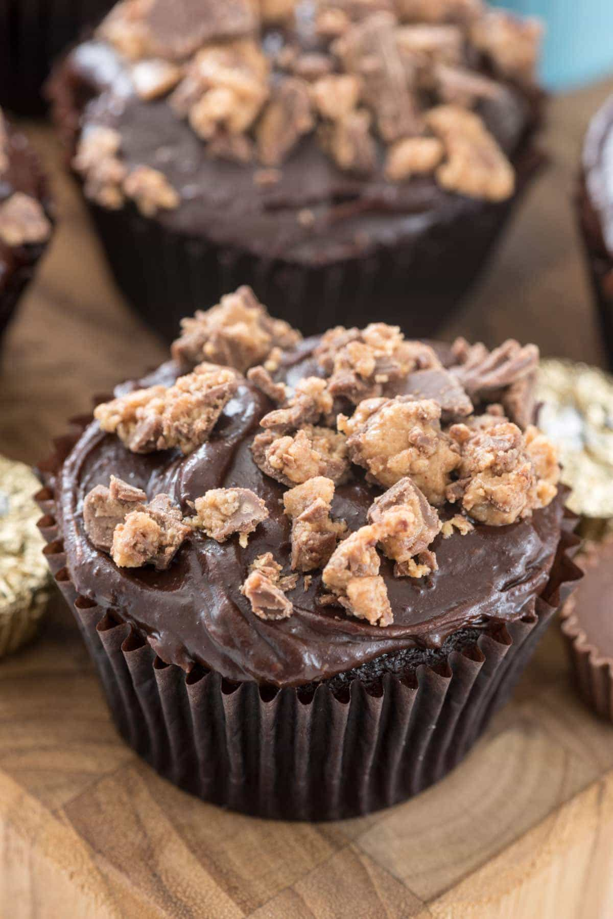 Peanut Butter Cup Cupcakes - chocolate cupcakes filled with peanut butter filling and topped with the BEST frosting!