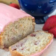 Strawberry banana bread loaf with one slice cut