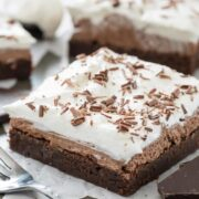 French silk brownie on parchment paper with chocolate shavings on top