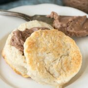 Southern style biscuit cut in half with chocolate spread in the middle