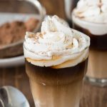 Close up of sweet cream shooter with whipped cream on top