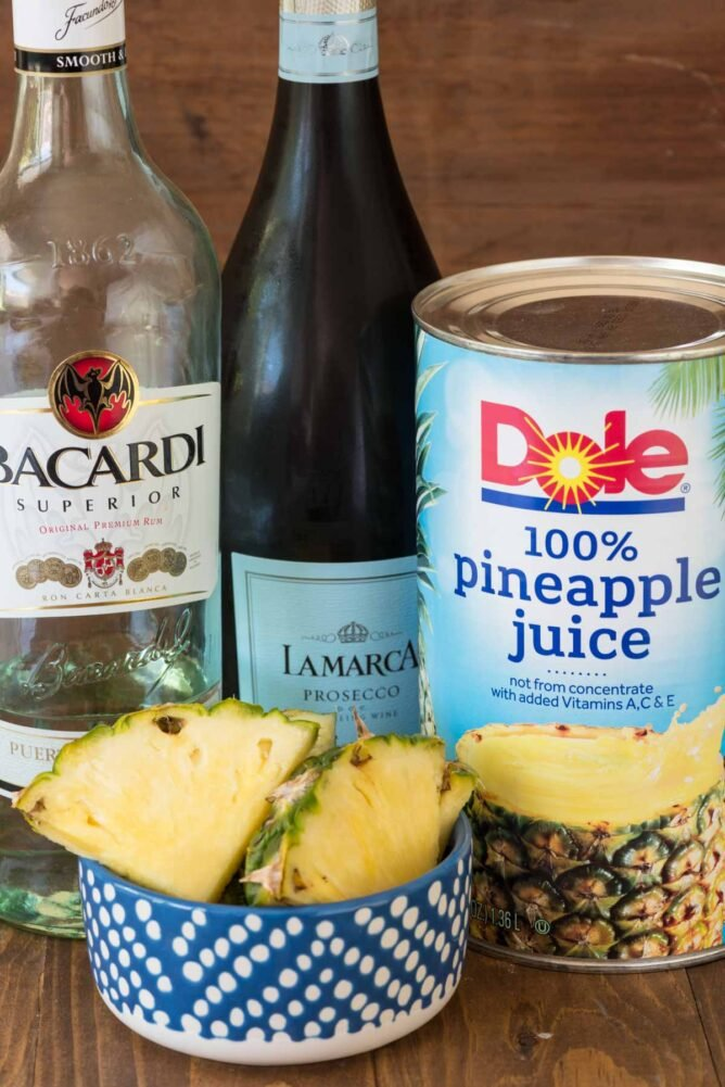 bottles of rum, prosecco and pineapple juice