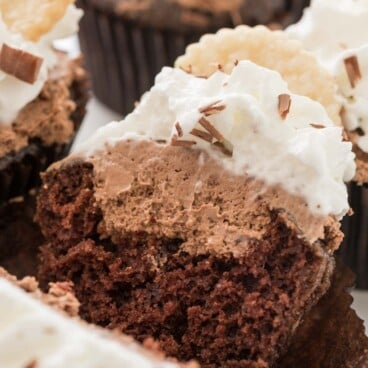 French silk cupcake split in half to show chocolate cream filling