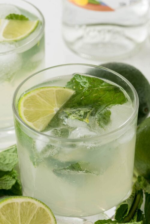 Mojito in a small cocktail glass with lime slices