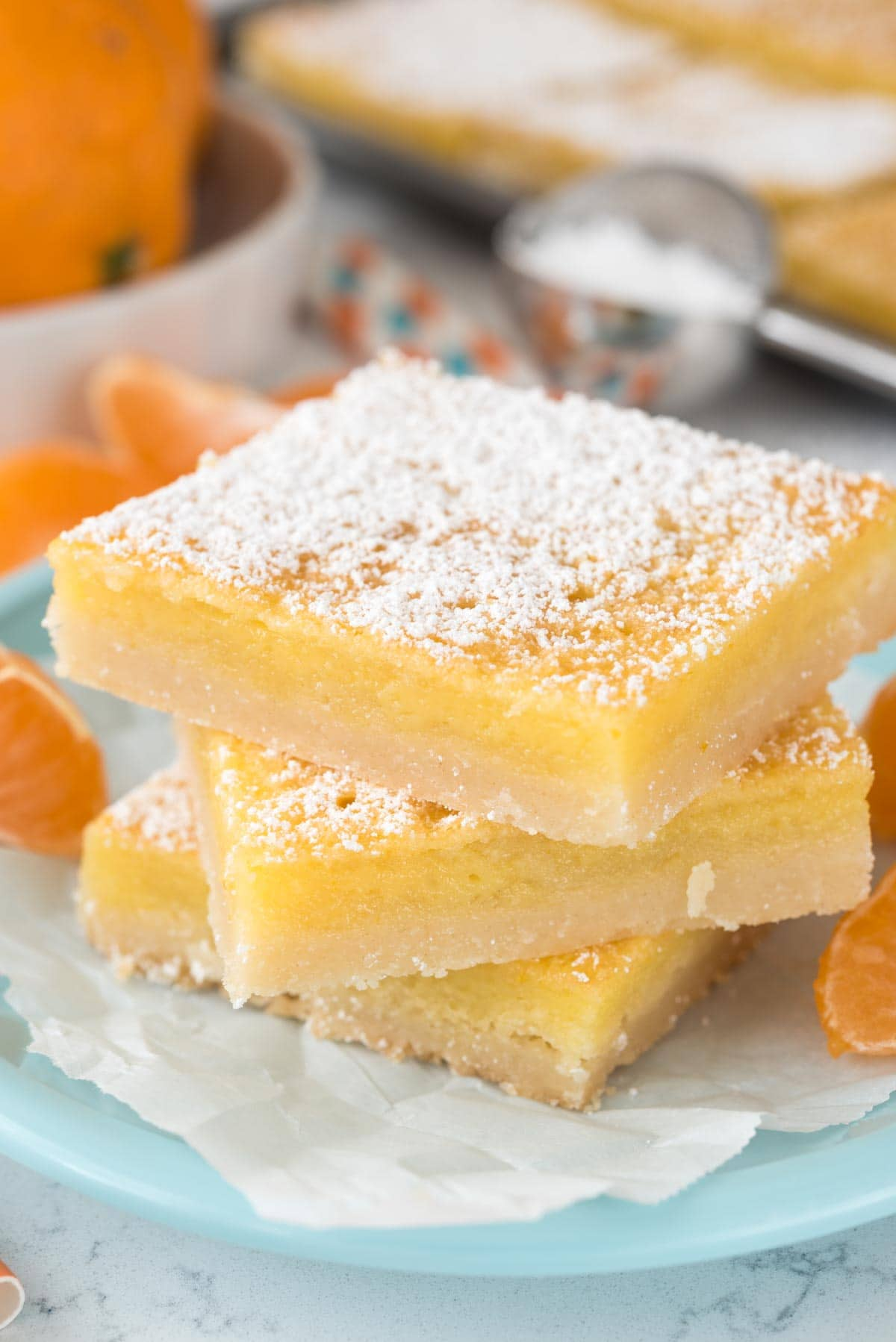 Orange Dream Bars - this easy recipe is like a lemon bar but with orange! Sweet and tart, they're the perfect dessert recipe!