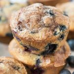 Two banana blueberry muffins on top of eachother