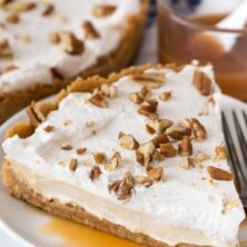 Slice of no bake butterscotch pie on white plate