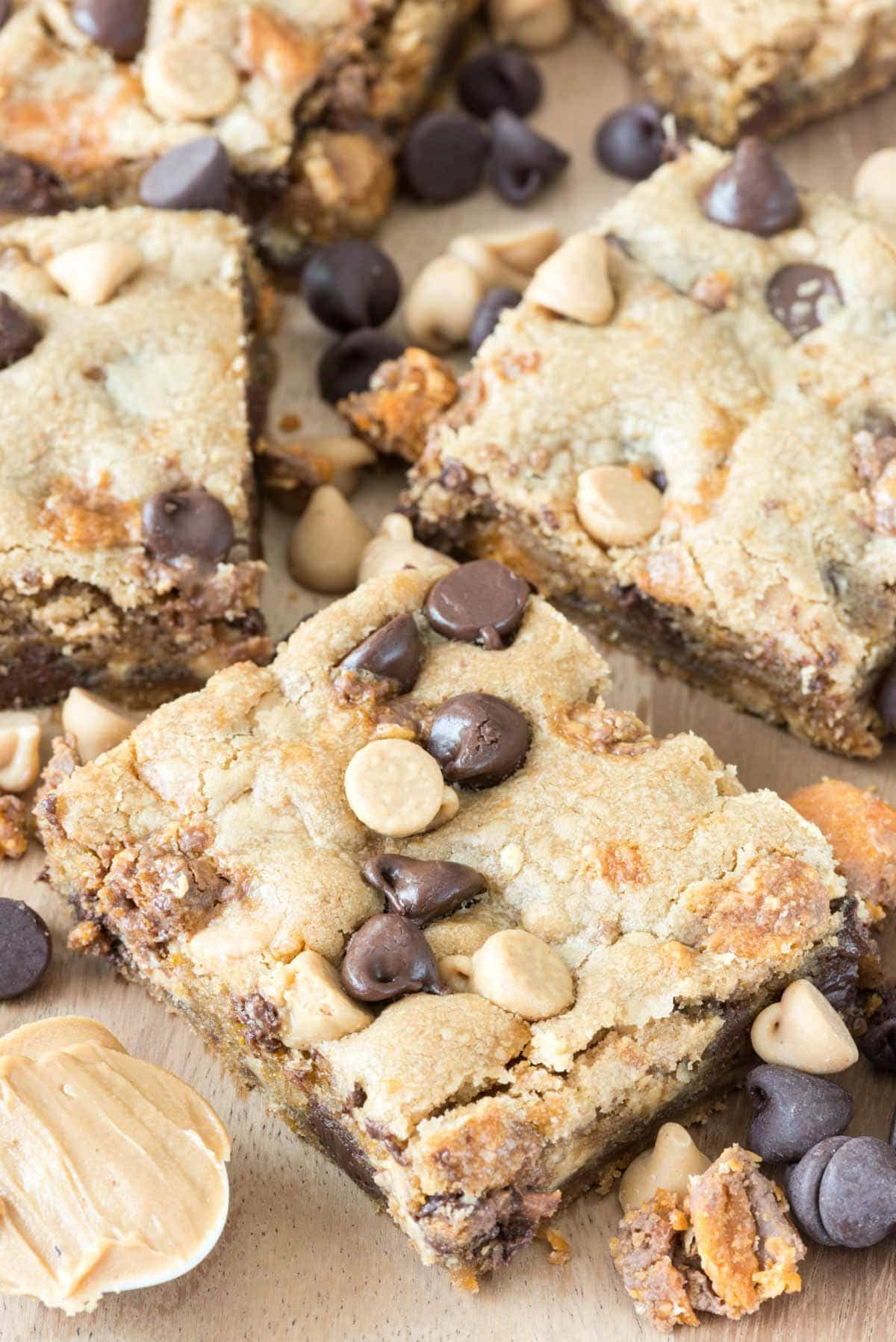 Triple Threat Peanut Butter Cookie Bars Recipe with peanut butter, peanut butter chips, Butterfingers, and chocolate!