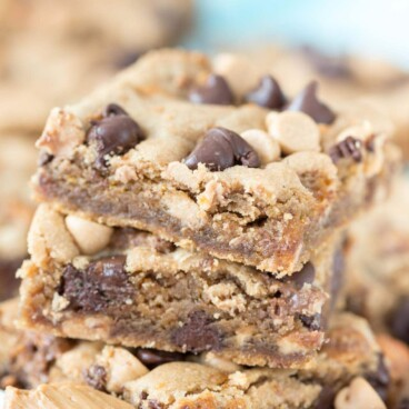 Stack of triple threat peanut butter cookie bars