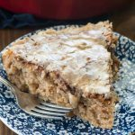 Apple fritter coffee cake slice on blue and white plate