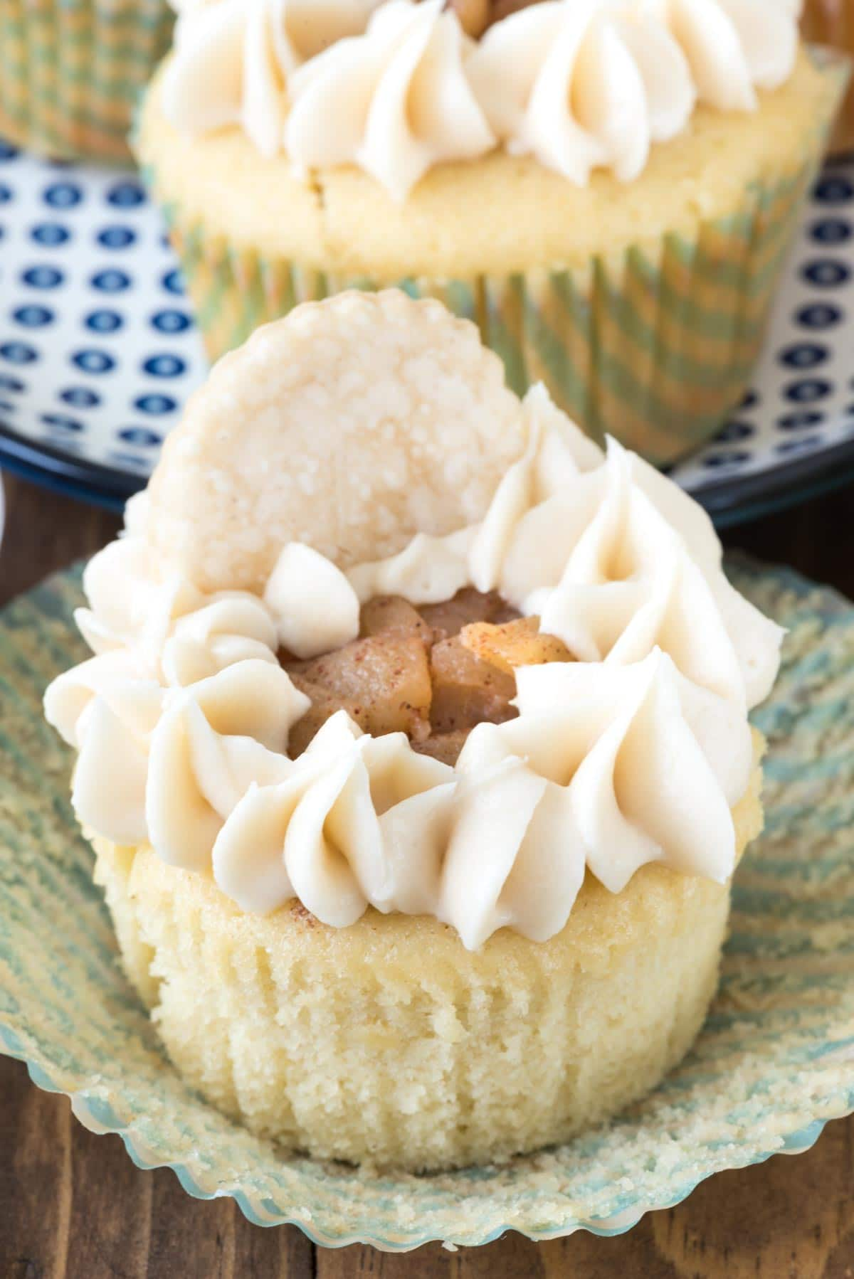 Apple Pie Cupcakes - My favorite vanilla cupcake recipe filled with homemade apple pie filling, topped off with frosting and a pie crust chip!
