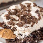 Piece of cocoa pebble no bake dessert on white plate