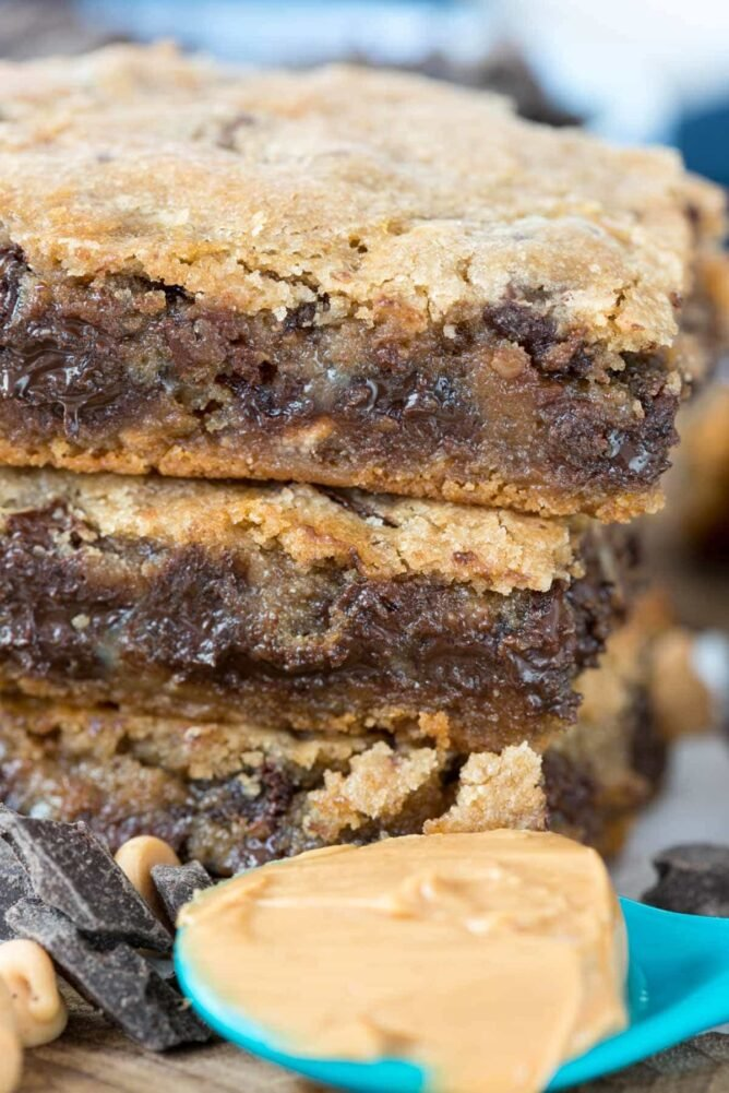 Double Decker Gooey bars with a spoon a peanut butter