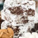 Stack of muddy buddy krispie treats with ingredients