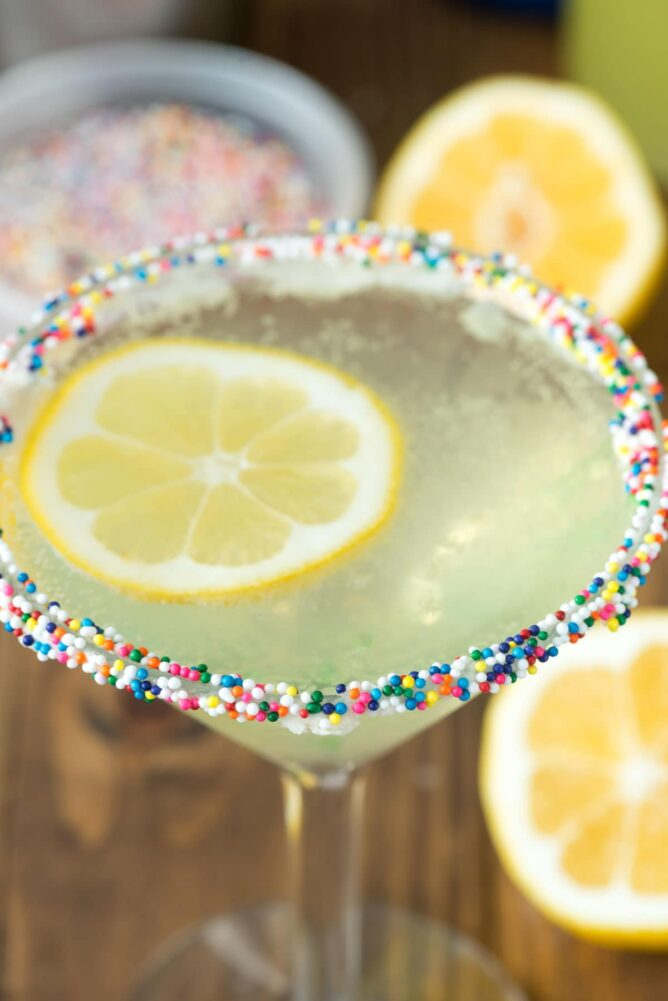 Lemon Cupcake martini in a Martini Glass with sprinkles on the rim