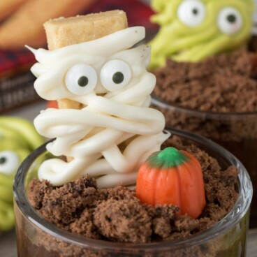 Close up of mummy dirt cup with monster dirt cup in background