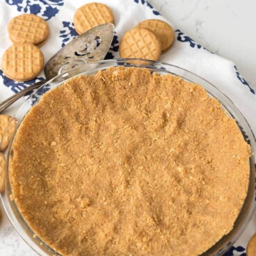 Overhead shot of peanut butter cookie crust on kitchen counter