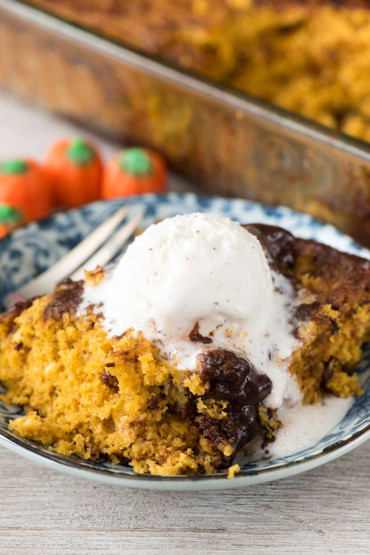 Pumpkin Hot Fudge Pudding Cake - this easy pumpkin cake recipe starts with a cake mix and is baked with chocolate that turns into hot fudge pudding!