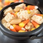 Close up of halloween snack mix in small halloween cauldron