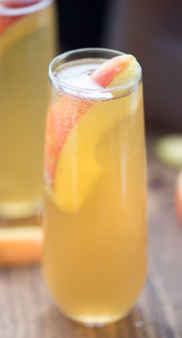 Apple cider bellini in a tall glass with and Apple slice