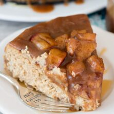 slice of caramel apple cheesecake on white plate