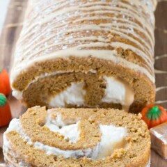 Caramel Pumpkin Cake Roll - an easy pumpkin roll cake filled with caramel ganache and cream cheese whipped cream. This is the BEST pumpkin roll recipe!