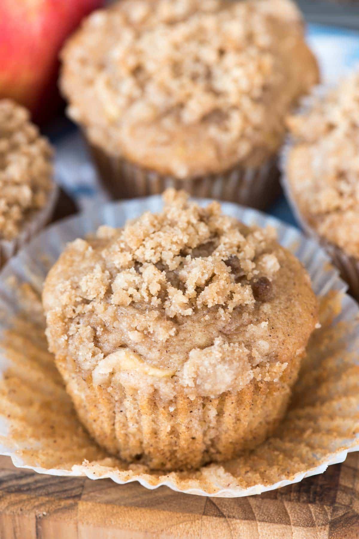 Easy Crumb Apple Muffins - the perfect fall breakfast! Simple muffins filled with cinnamon and cinnamon apples then topped with a brown sugar crumble!