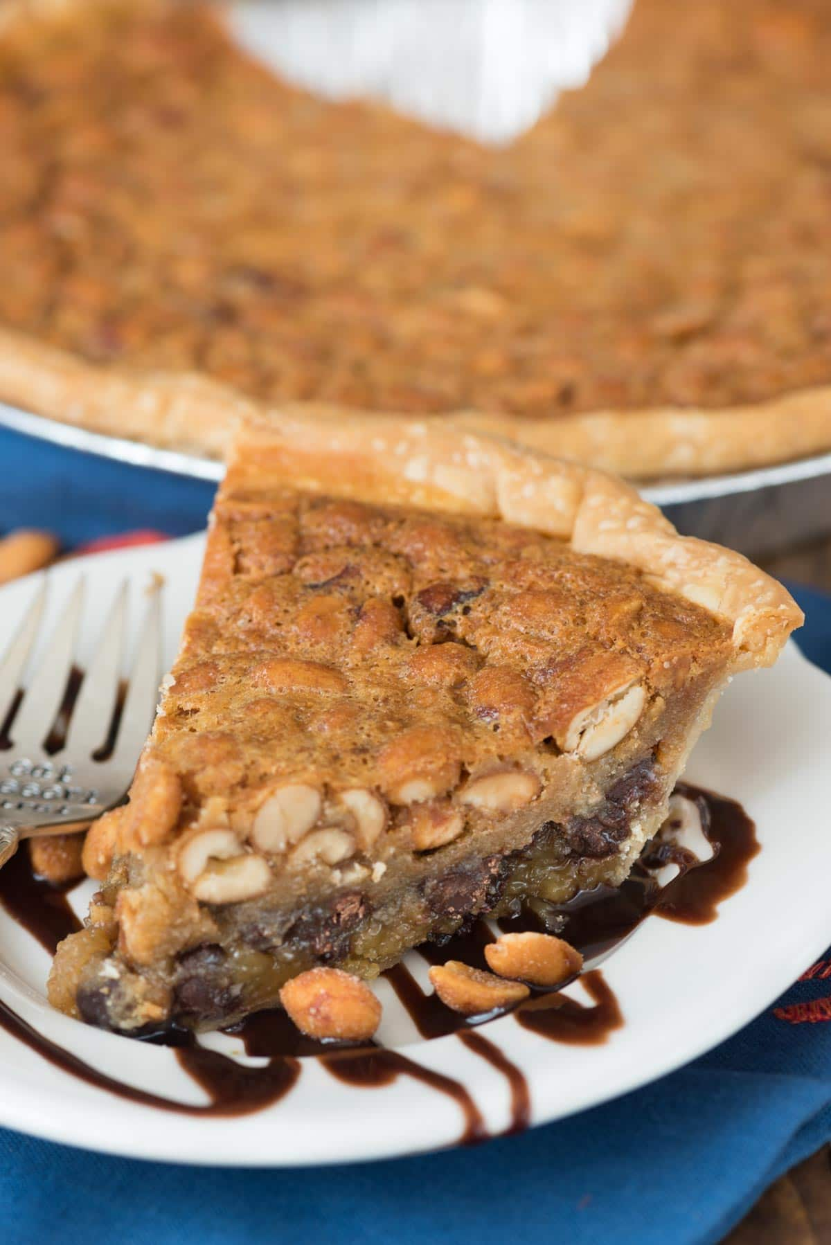 Chocolate Peanut Pie - this EASY pie recipe is full of peanut butter and chocolate with a gooey sweet center.