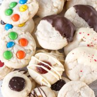 Soft chewy shortbread cookies are made from one shortbread recipe, with 4 cookie recipe variations. Add M&Ms, dip them in chocolate, or make shortbread thumbprint cookies!