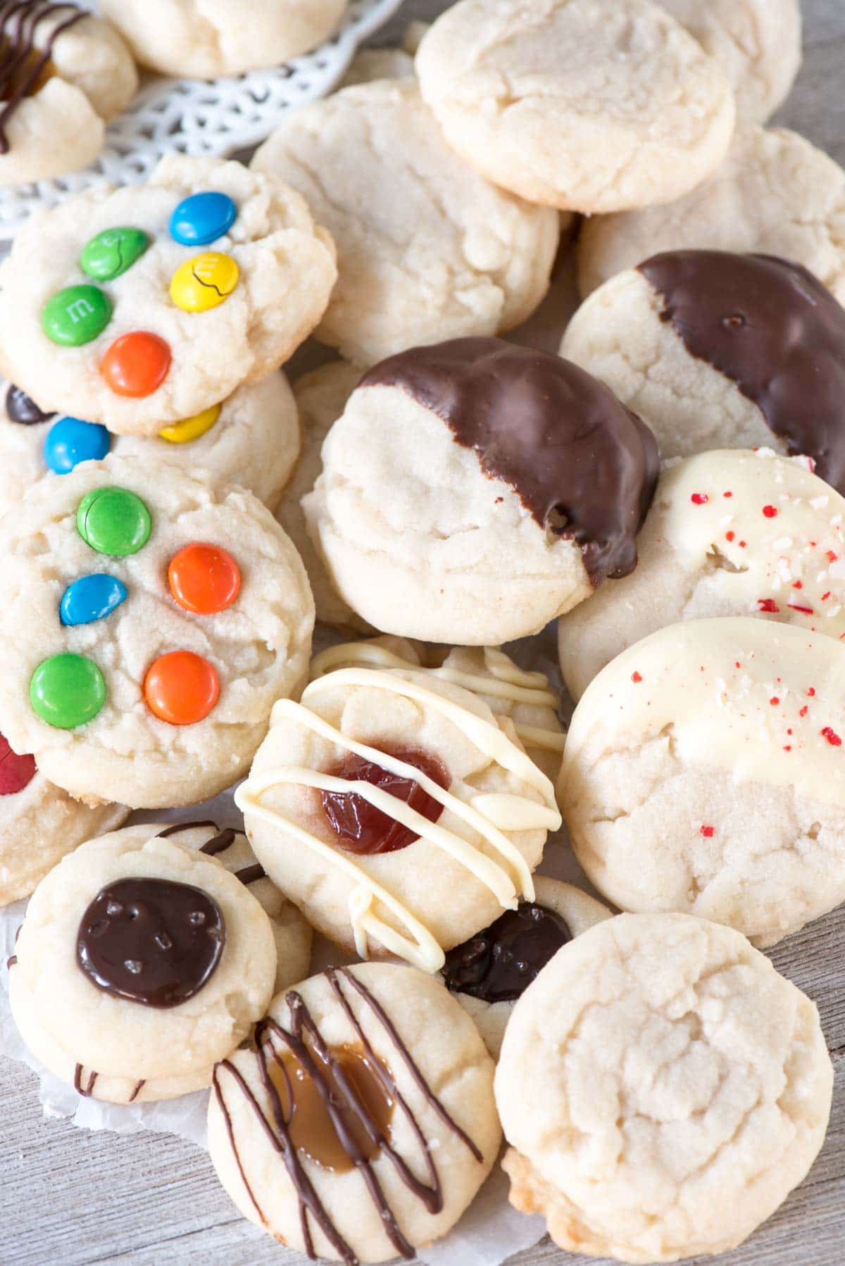 Soft and Chewy Shortbread Cookies - this easy cookie recipe has one dough and can be made 4 ways! There are only 4 ingredients in the basic shortbread dough and it bakes up to a soft and chewy cookie!