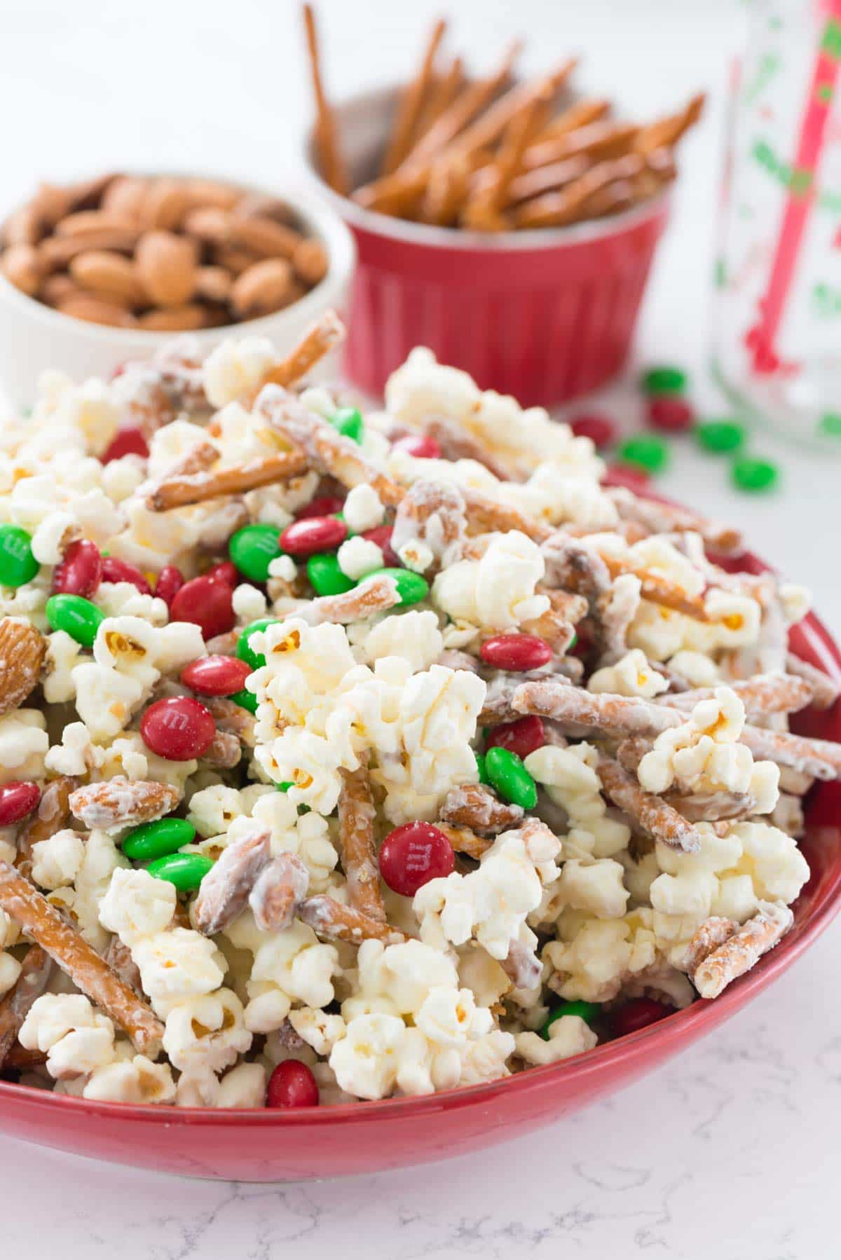 Santa Munch Mix - this EASY 5 ingredient Popcorn Snack Mix is coated in white chocolate and makes the perfect snack for Christmas! Santa loves it...but the kids do too!