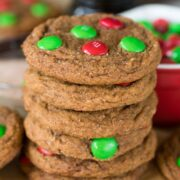 stack of molasses cookies with christmas m&ms