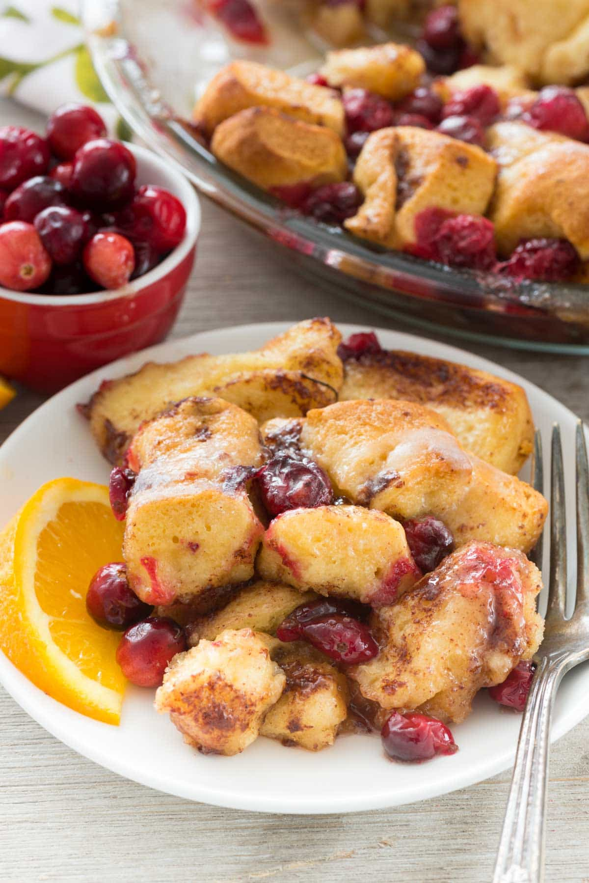 Cranberry Cinnamon Roll Bake - this easy bubble up bake recipe starts with cinnamon rolls. Add fresh cranberries for a holiday breakfast!