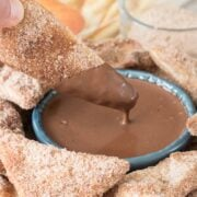 Baked Churro Chips being dipped in Chocolate