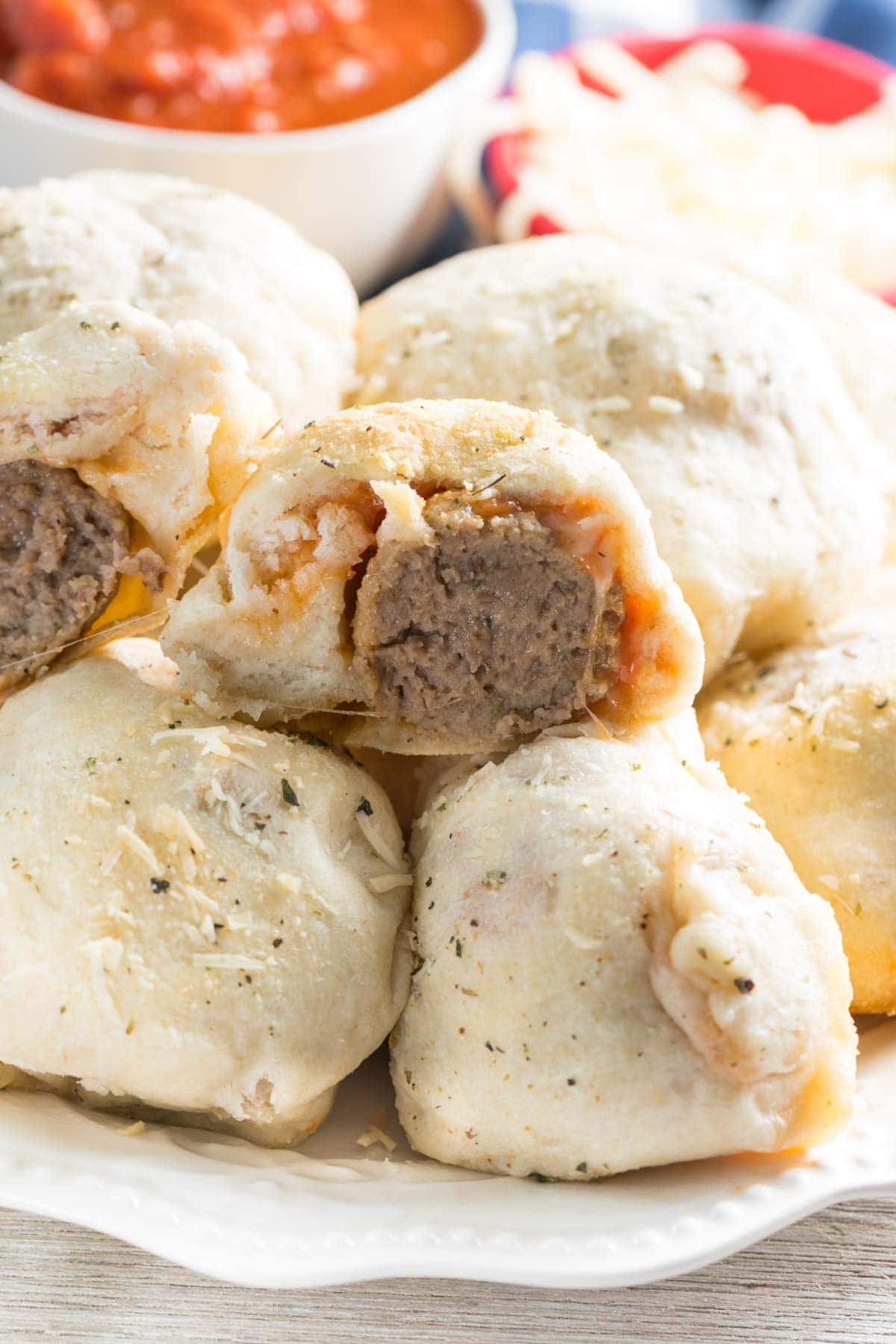 Meatball Sub Bites - this easy appetizer recipe has just 4 main ingredients and is perfect for a party or lunch. Wrap frozen meatballs in biscuit dough for a handheld meatball sub in a bite!