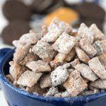 Peanut Butter Cookies n Cream Muddy Buddies in a blue bowl