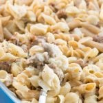 Sausage macaroni and cheese in a blue casserole dish