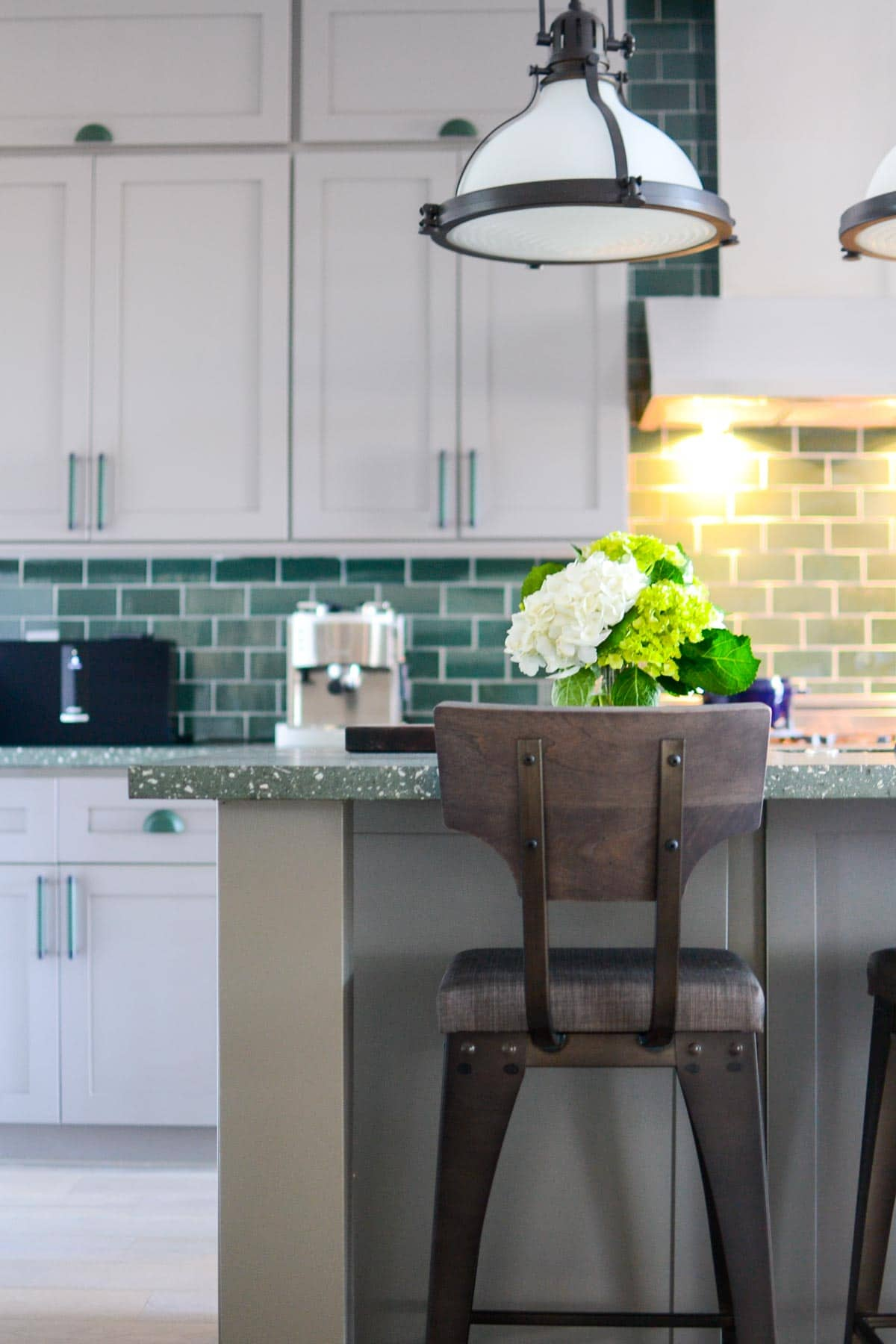 7 Tips for decorating a GREEN kitchen: rustic touches in furniture helps ground the green throughout.