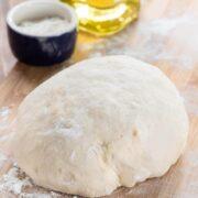 dough on cutting board still in a ball