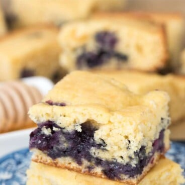 Two sliced of Blueberry Cornbread on a blue serving plate.
