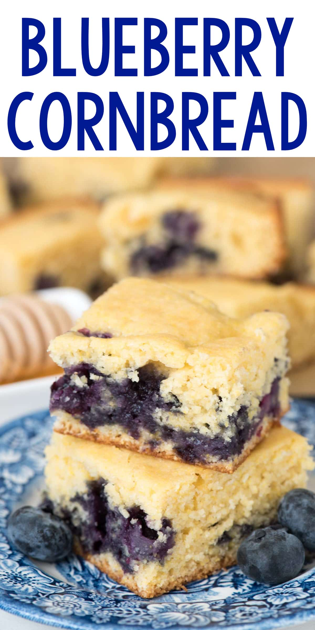 Blueberry Cornbread on a blue plate with blueberries on the side.