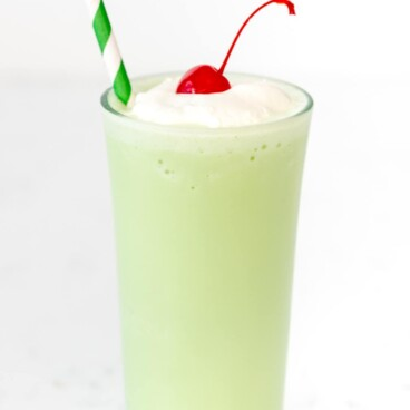 Copycat Mint Shake in a tall glass with a straw