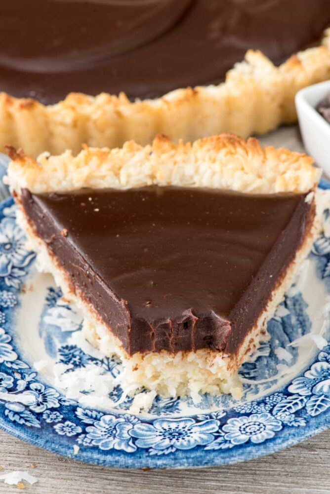 slice of chocolate macaroon pie on a blue and white plate