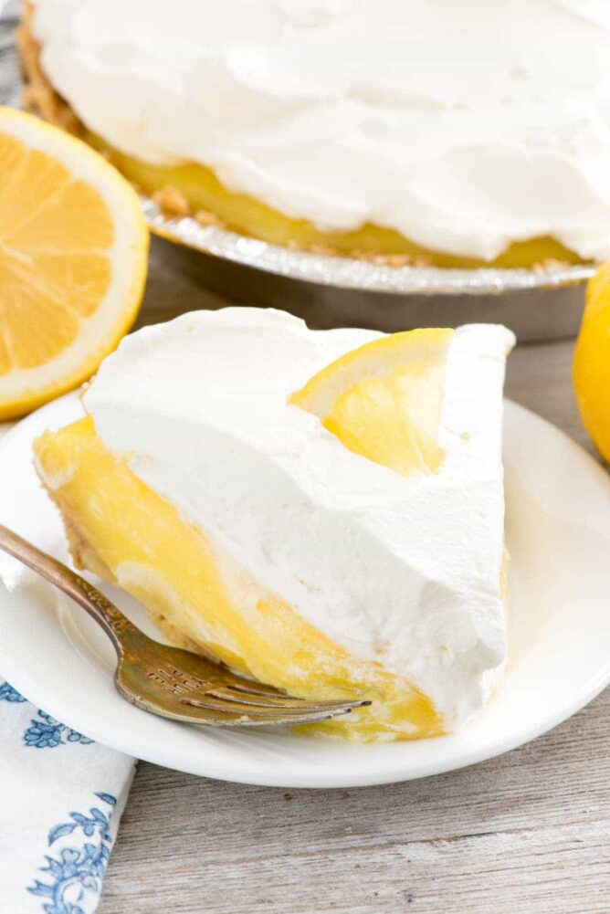 No Bake Lemon Cream Pie on a white plate with a fork