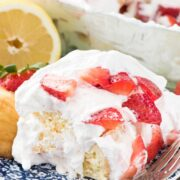 No Bake Strawberry Lemon Cake on a blue plate with a fork