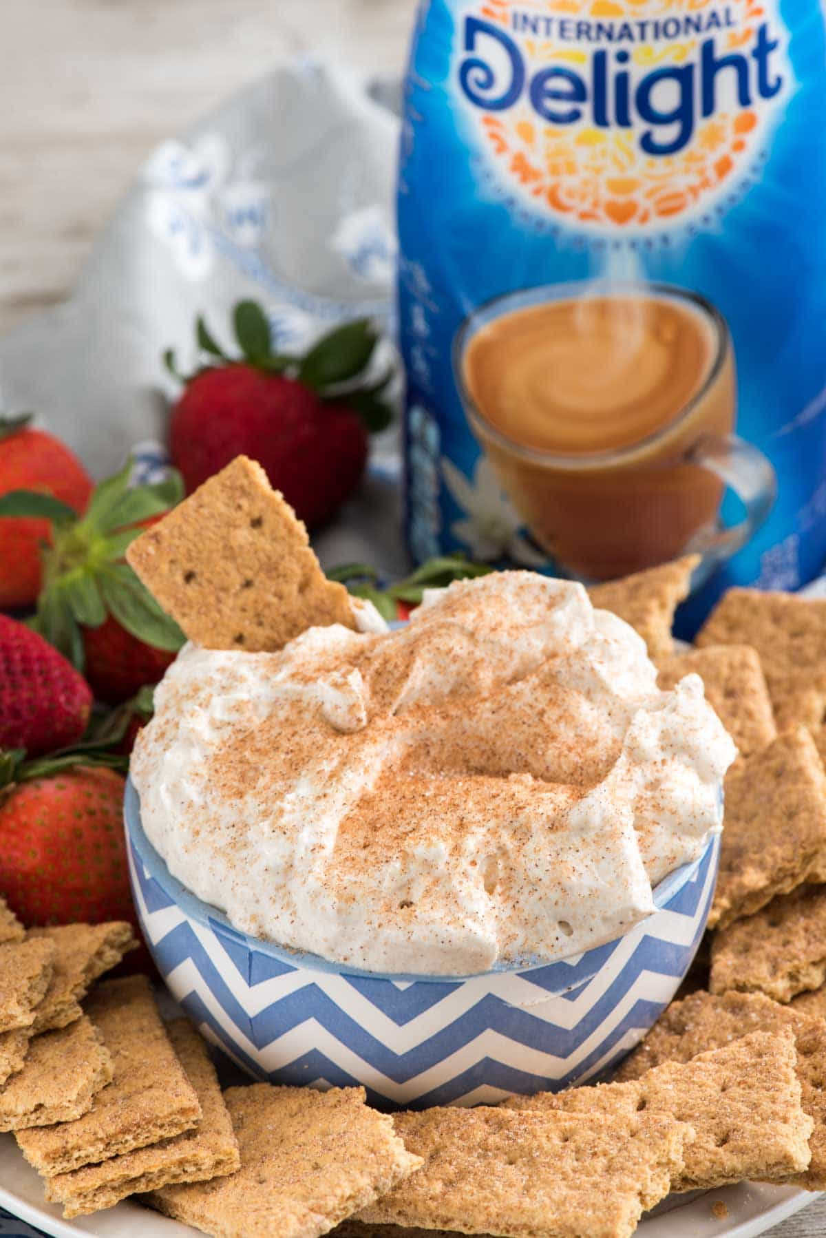 Churro Cheesecake Dip - an easy way to make no-bake cheesecake dip full of cinnamon sugar churro flavor! This is perfect for parties or an easy dessert; we loved it!